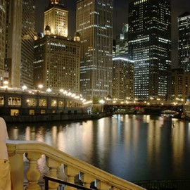 Man by the Chicago River at Night